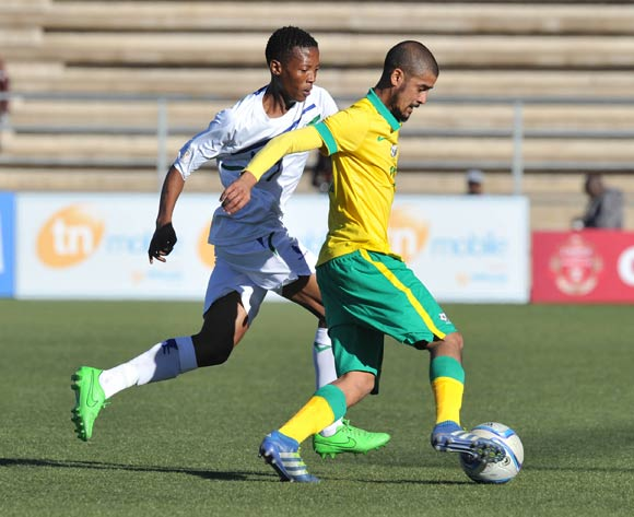 Abbubaker Mobara of South Africa challenged by Hlompho Kalake of Lesotho during the 2016 Cosafa Cup Quarterfinals match between South Africa and Lesotho at Sam Nujoma Stadium in Windhoek Namibia on 18 June, 2016 ©Muzi Ntombela/BackpagePix