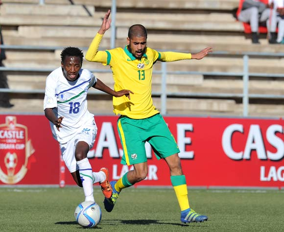 Tumelo Khutlang of Lesotho challenged by Abbubaker Mobara of South Africa during the 2016 Cosafa Cup Quarterfinals match between South Africa and Lesotho at Sam Nujoma Stadium in Windhoek Namibia on 18 June, 2016 ©Muzi Ntombela/BackpagePix