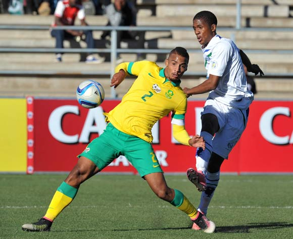 Seturumane Tsepo of Lesotho closed by Rivaldo Coetzee of South Africa during the 2016 Cosafa Cup Quarterfinals match between South Africa and Lesotho at Sam Nujoma Stadium in Windhoek Namibia on 18 June, 2016 ©Muzi Ntombela/BackpagePix