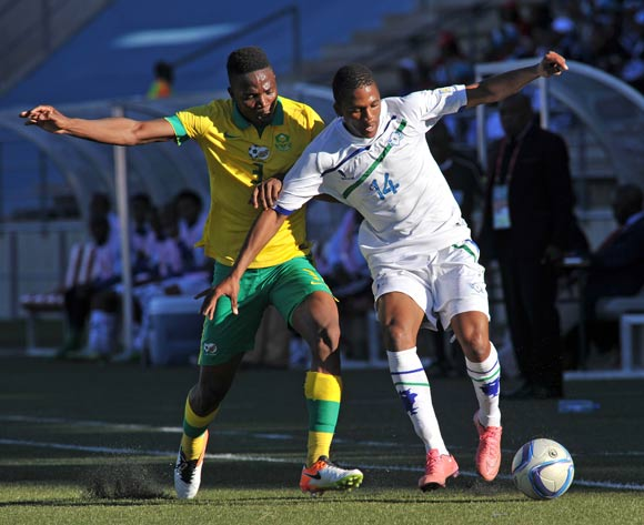 Seturumane Tsepo of Lesotho challenged by Mbhazima Rikhotso of South Africa during the 2016 Cosafa Cup Quarterfinals match between South Africa and Lesotho at Sam Nujoma Stadium in Windhoek Namibia on 18 June, 2016 ©Muzi Ntombela/BackpagePix