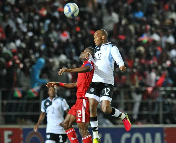 Chris Katjiukua of Namibia challenges Lemponye Tshireletso of Botswana during the 2016 Cosafa Cup Quarterfinals match between Botswana and Namibia at Sam Nujoma Stadium in Windhoek Namibia on 18 June, 2016 ©Muzi Ntombela/BackpagePix