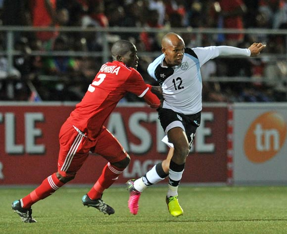 Lemponye Tshireletso of Botswana challenged by Denzil Haoseb of Namibia during the 2016 Cosafa Cup Quarterfinals match between Botswana and Namibia at Sam Nujoma Stadium in Windhoek Namibia on 18 June, 2016 ©Muzi Ntombela/BackpagePix