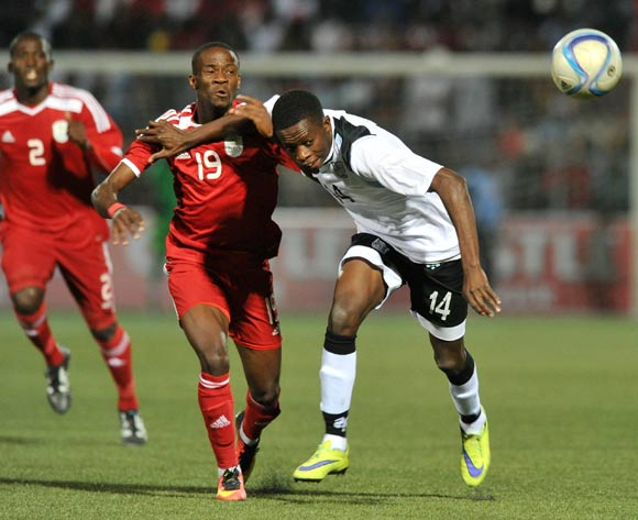 Thabang Sesinyi of Botswana challenged by Larry Horaeb of Namibia during the 2016 Cosafa Cup Quarterfinals match between Botswana and Namibia at Sam Nujoma Stadium in Windhoek Namibia on 18 June, 2016 ©Muzi Ntombela/BackpagePix