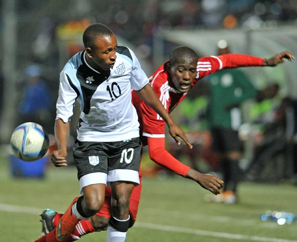 Onkabetse Makgantai of Botswana fouled by Denzil Haoseb of Namibia during the 2016 Cosafa Cup Quarterfinals match between Botswana and Namibia at Sam Nujoma Stadium in Windhoek Namibia on 18 June, 2016 ©Muzi Ntombela/BackpagePix