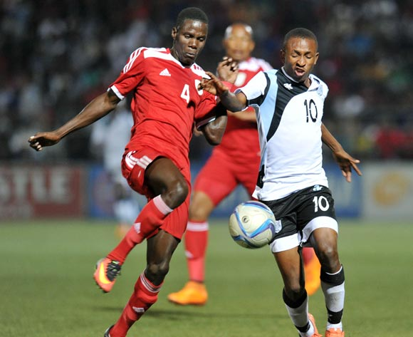 Onkabetse Makgantai of Botswana challenged by Ferdinand Karongee of Namibia during the 2016 Cosafa Cup Quarterfinals match between Botswana and Namibia at Sam Nujoma Stadium in Windhoek Namibia on 18 June, 2016 ©Muzi Ntombela/BackpagePix