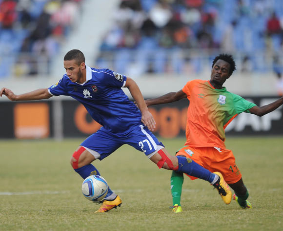 Ramadan Ahmed of Al Ahly is challenged by John Chingandu of Zesco during the CAF Champions League match between Zesco and Al Ahly on 18 June 2016 at St Peter's College Pic Sydney Mahlangu/ BackpagePix