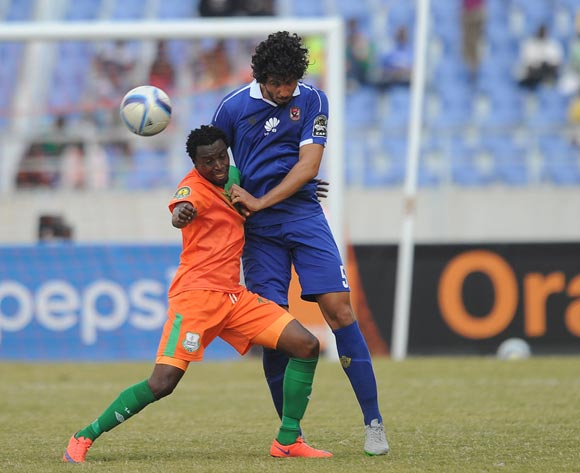 Ahmed Hegazi of Al Ahly is challenged by Jackson Mwanza  of Zesco during the CAF Champions League match between Zesco and Al Ahly on 18 June 2016 at St Peter's College Pic Sydney Mahlangu/ BackpagePix
