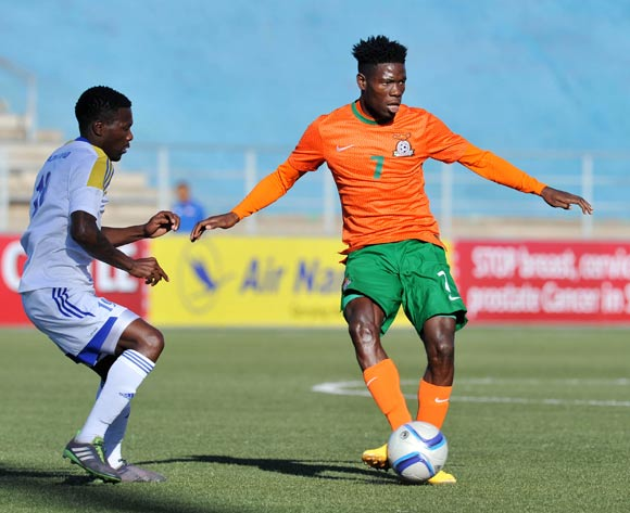 Salulani Phiri of Zambia challenged by Mcolisi Lukhele of Swaziland during the 2016 Cosafa Cup Quarterfinals match between Zambia and Swaziland at Sam Nujoma Stadium in Windhoek Namibia on 19 June, 2016 ©Muzi Ntombela/BackpagePix