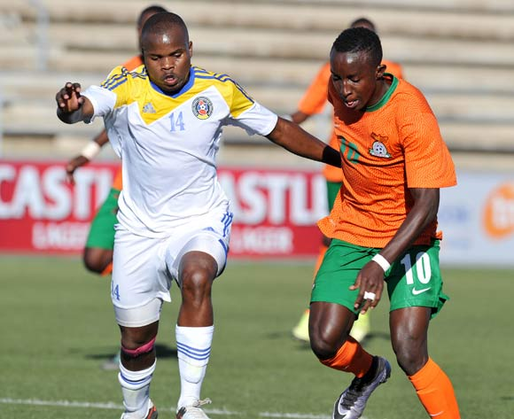 Machawe Dlamini of Swaziland challenges Conlyde Luchanga of Zambia during the 2016 Cosafa Cup Quarterfinals match between Zambia and Swaziland at Sam Nujoma Stadium in Windhoek Namibia on 19 June, 2016 ©Muzi Ntombela/BackpagePix