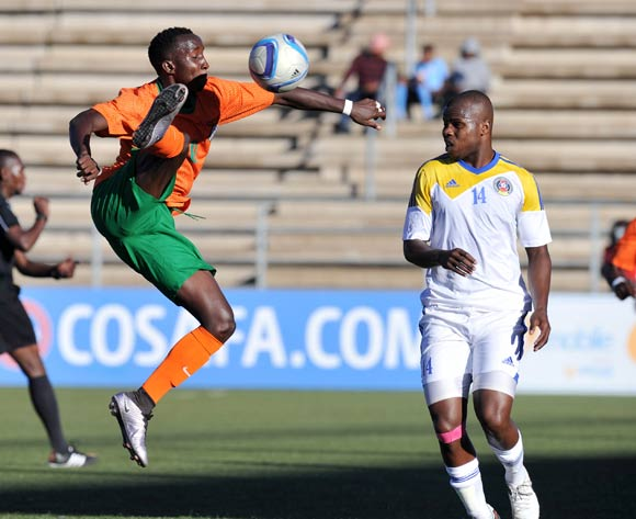 Conlyde Luchanga of Zambia clears ball from Machawe Dlamini of Swaziland during the 2016 Cosafa Cup Quarterfinals match between Zambia and Swaziland at Sam Nujoma Stadium in Windhoek Namibia on 19 June, 2016 ©Muzi Ntombela/BackpagePix