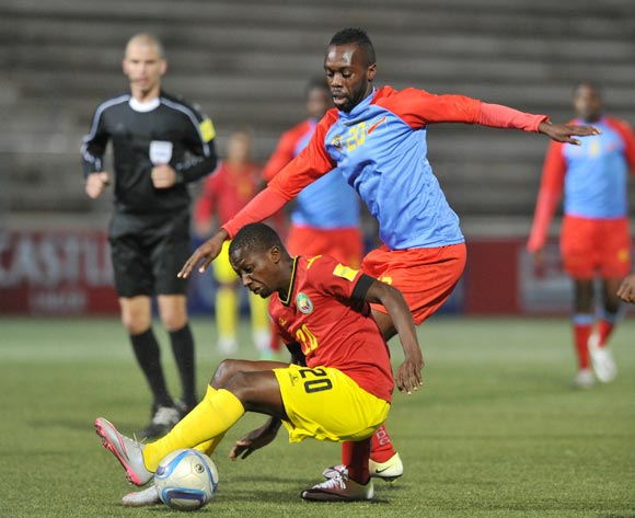 Sedeick Ngulubi of DR Congo challenged by Pedro Timbe of Mozambique during the 2016 Cosafa Cup Quarterfinals match between DR Congo and Mozambique at Sam Nujoma Stadium in Windhoek Namibia on 19 June, 2016 ©Muzi Ntombela/BackpagePix