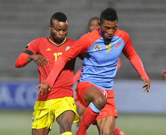 Lobi Manzoki of DR Congo challenged by Lourenco Waruma of Mozambique during the 2016 Cosafa Cup Quarterfinals match between DR Congo and Mozambique at Sam Nujoma Stadium in Windhoek Namibia on 19 June, 2016 ©Muzi Ntombela/BackpagePix