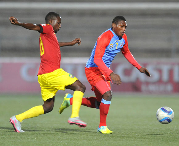 Mombo Lusala of DR Congo challenged by Pedro Timbe of Mozambique during the 2016 Cosafa Cup Quarterfinals match between DR Congo and Mozambique at Sam Nujoma Stadium in Windhoek Namibia on 19 June, 2016 ©Muzi Ntombela/BackpagePix