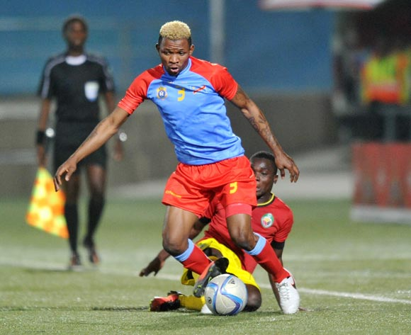Lomalisa Mutambala of DR Congo tackled by Luis Miquissone of Mozambique during the 2016 Cosafa Cup Quarterfinals match between DR Congo and Mozambique at Sam Nujoma Stadium in Windhoek Namibia on 19 June, 2016 ©Muzi Ntombela/BackpagePix
