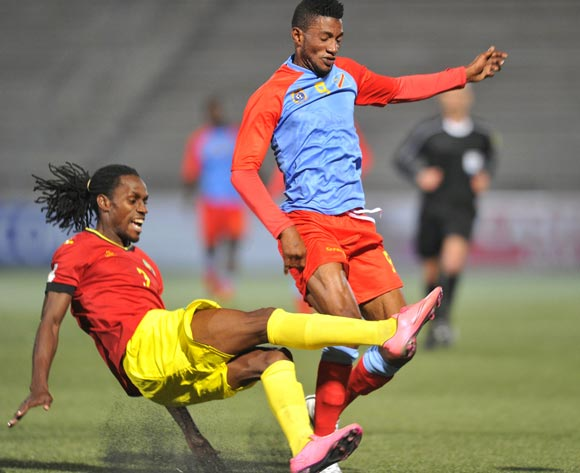 Lobi Manzoki of DR Congo tackled by Teca Jorge of Mozambique during the 2016 Cosafa Cup Quarterfinals match between DR Congo and Mozambique at Sam Nujoma Stadium in Windhoek Namibia on 19 June, 2016 ©Muzi Ntombela/BackpagePix