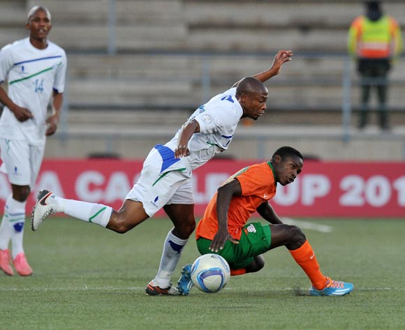 Spencer Sautu of Zambia fouled by Jeremea Kamela of Lesotho during the 2016 Cosafa Cup Plate Semifinal  match between Lesotho and Zambia at Sam Nujoma Stadium in Windhoek Namibia on 21 June, 2016 ©Muzi Ntombela/BackpagePix