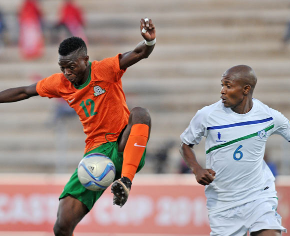 Patson Daka of Zambia challenged by Kopano Tseka of Lesotho during the 2016 Cosafa Cup Plate Semifinal  match between Lesotho and Zambia at Sam Nujoma Stadium in Windhoek Namibia on 21 June, 2016 ©Muzi Ntombela/BackpagePix