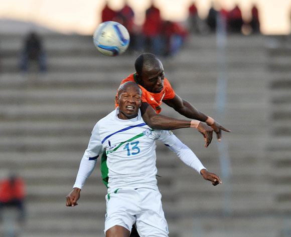 Jane Thaba-Ntso of Lesotho challenged by Donashano Malama of Zambia during the 2016 Cosafa Cup Plate Semifinal  match between Lesotho and Zambia at Sam Nujoma Stadium in Windhoek Namibia on 21 June, 2016 ©Muzi Ntombela/BackpagePix