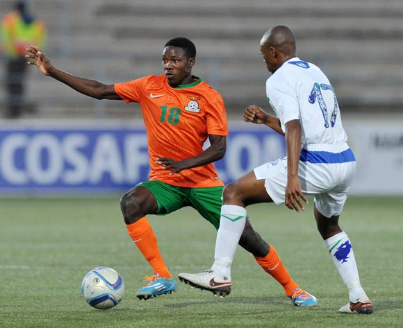 Spencer Sautu of Zambia challenged by Jeremea Kamela of Lesotho during the 2016 Cosafa Cup Plate Semifinal  match between Lesotho and Zambia at Sam Nujoma Stadium in Windhoek Namibia on 21 June, 2016 ©Muzi Ntombela/BackpagePix