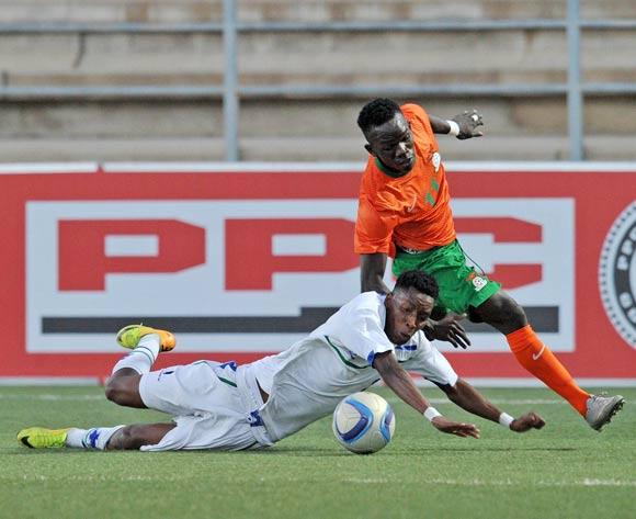Sepiriti Malefane of Lesotho fouled by Charles Zulu of Zambia during the 2016 Cosafa Cup Plate Semifinal  match between Lesotho and Zambia at Sam Nujoma Stadium in Windhoek Namibia on 21 June, 2016 ©Muzi Ntombela/BackpagePix