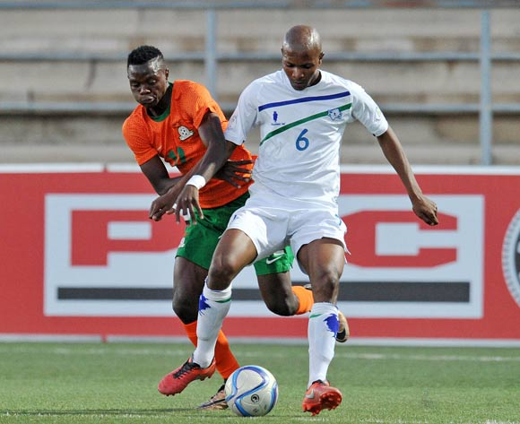 Kopano Tseka of Lesotho chalkenged by Patson Daka of Zambia during the 2016 Cosafa Cup Plate Semifinal  match between Lesotho and Zambia at Sam Nujoma Stadium in Windhoek Namibia on 21 June, 2016 ©Muzi Ntombela/BackpagePix