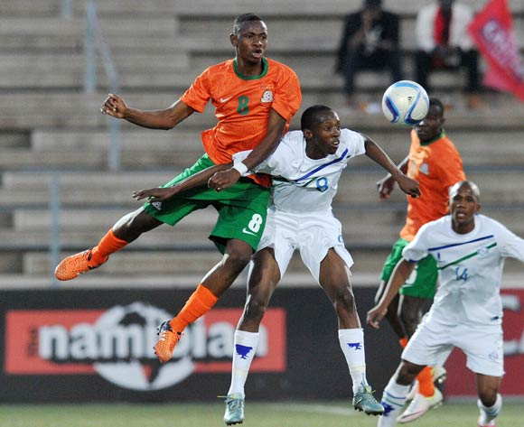 Phafa Tsosane of Lesotho challenged by Paul Katema of Zambia during the 2016 Cosafa Cup Plate Semifinal  match between Lesotho and Zambia at Sam Nujoma Stadium in Windhoek Namibia on 21 June, 2016 ©Muzi Ntombela/BackpagePix