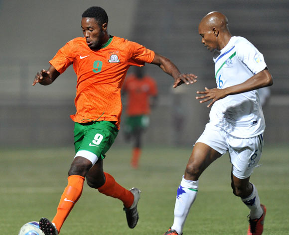 Festus Mbewe of Zambia challenged by Kopano Tseka of Lesotho during the 2016 Cosafa Cup Plate Semifinal  match between Lesotho and Zambia at Sam Nujoma Stadium in Windhoek Namibia on 21 June, 2016 ©Muzi Ntombela/BackpagePix