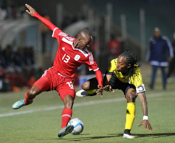 Peter Shalilule of Namibia challenged by Joao Mussica of Mozambique during the 2016 Cosafa Cup Plate Semifinal  match between Namibia and Mozambique at Sam Nujoma Stadium in Windhoek Namibia on 21 June, 2016 ©Muzi Ntombela/BackpagePix