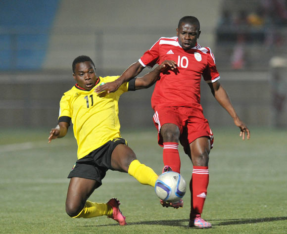 Luis Miquissone of Mozambique tackles Wangu Gome of Namibia during the 2016 Cosafa Cup Plate Semifinal  match between Namibia and Mozambique at Sam Nujoma Stadium in Windhoek Namibia on 21 June, 2016 ©Muzi Ntombela/BackpagePix
