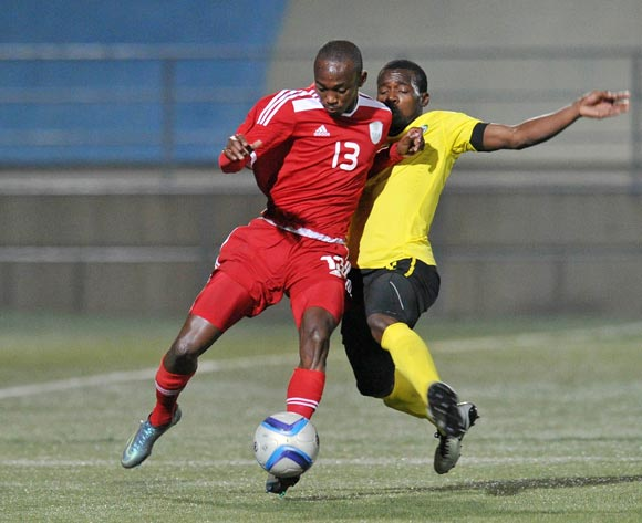 Peter Shalilule of Namibia tackled by Bruno Alberto Langa of Mozambique during the 2016 Cosafa Cup Plate Semifinal  match between Namibia and Mozambique at Sam Nujoma Stadium in Windhoek Namibia on 21 June, 2016 ©Muzi Ntombela/BackpagePix