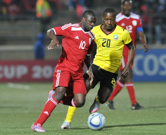 Wangu Gome of Namibia challenged by Pedro Timbe of Mozambique during the 2016 Cosafa Cup Plate Semifinal  match between Namibia and Mozambique at Sam Nujoma Stadium in Windhoek Namibia on 21 June, 2016 ©Muzi Ntombela/BackpagePix