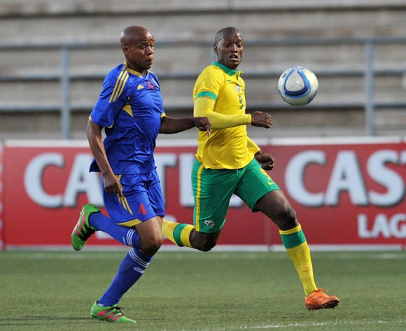 Siyabonga Mduli of Swaziland challenged by Judas Moseamedi of South Africa during the 2016 Cosafa Cup Semifinal  match between South Africa and Swaziland at Sam Nujoma Stadium in Windhoek Namibia on 22 June, 2016 ©Muzi Ntombela/BackpagePix