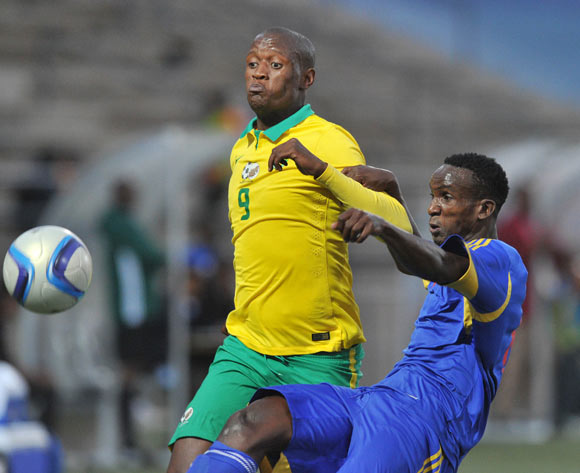 Sabelo Gamedze of Swaziland clears ball from Judas Moseamedi of South Africa during the 2016 Cosafa Cup Semifinal  match between South Africa and Swaziland at Sam Nujoma Stadium in Windhoek Namibia on 22 June, 2016 ©Muzi Ntombela/BackpagePix