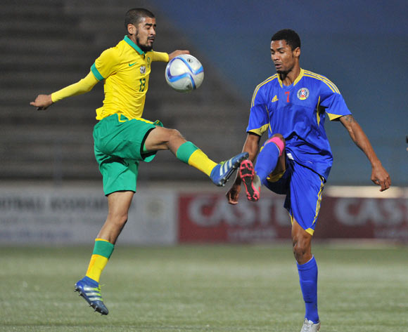 Abbubaker Mobara of South Africa challenged by Felix Badenhorst of Swaziland during the 2016 Cosafa Cup Semifinal  match between South Africa and Swaziland at Sam Nujoma Stadium in Windhoek Namibia on 22 June, 2016 ©Muzi Ntombela/BackpagePix