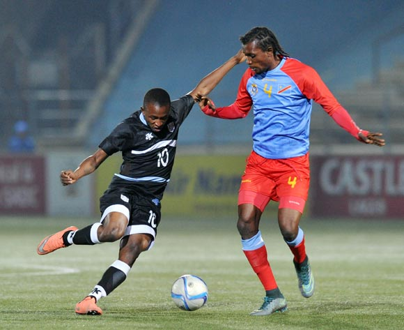 Onkabetse Makgantai of Botswana challenged by Bompunga Botuli of DR Congo during the 2016 Cosafa Cup Semifinal match between Botswana and DR Congo at Sam Nujoma Stadium in Windhoek Namibia on 22 June, 2016 ©Muzi Ntombela/BackpagePix