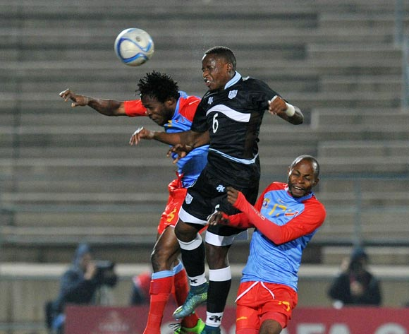 Thato Kebue of Botswana challenged by Mukoko Batezadio (l) and Guy Basisila of DR Congo during the 2016 Cosafa Cup Semifinal match between Botswana and DR Congo at Sam Nujoma Stadium in Windhoek Namibia on 22 June, 2016 ©Muzi Ntombela/BackpagePix