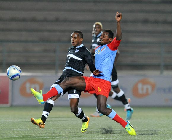 Kabelo Seakanyeng of Botswana challenged by Nelson Omba of DR Congo during the 2016 Cosafa Cup Semifinal match between Botswana and DR Congo at Sam Nujoma Stadium in Windhoek Namibia on 22 June, 2016 ©Muzi Ntombela/BackpagePix
