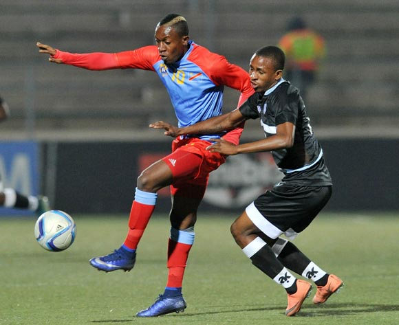 Lema Mabidi of DR Congo challenged by Onkabetse Makgantai of Botswana during the 2016 Cosafa Cup Semifinal match between Botswana and DR Congo at Sam Nujoma Stadium in Windhoek Namibia on 22 June, 2016 ©Muzi Ntombela/BackpagePix
