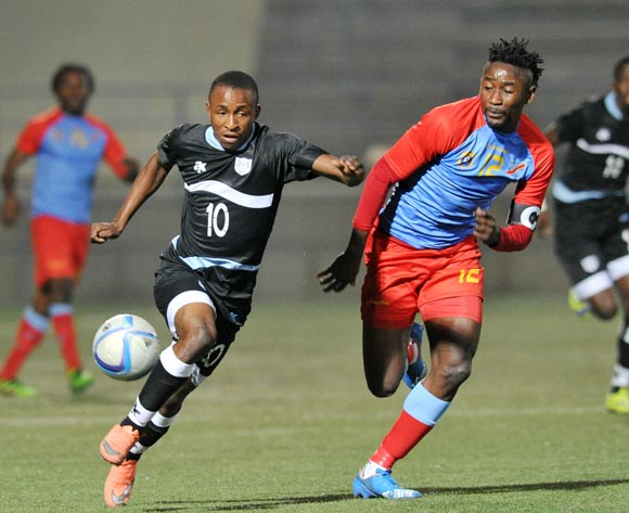 Bodrick Muselenge of DR Congo challenges Onkabetse Makgantai of Botswana during the 2016 Cosafa Cup Semifinal match between Botswana and DR Congo at Sam Nujoma Stadium in Windhoek Namibia on 22 June, 2016 ©Muzi Ntombela/BackpagePix