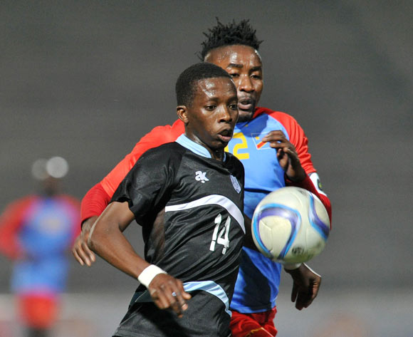 Thabang Sesinyi of Botswana challenged by Bodrick Muselenge of DR Congo during the 2016 Cosafa Cup Semifinal match between Botswana and DR Congo at Sam Nujoma Stadium in Windhoek Namibia on 22 June, 2016 ©Muzi Ntombela/BackpagePix