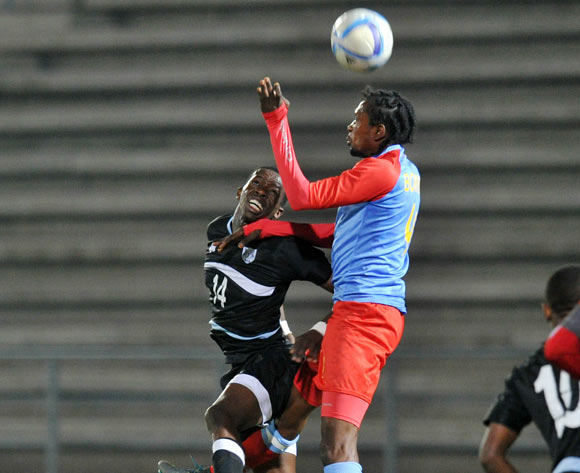 Thabang Sesinyi of Botswana challenged by Bompunga Botuli of DR Congo during the 2016 Cosafa Cup Semifinal match between Botswana and DR Congo at Sam Nujoma Stadium in Windhoek Namibia on 22 June, 2016 ©Muzi Ntombela/BackpagePix