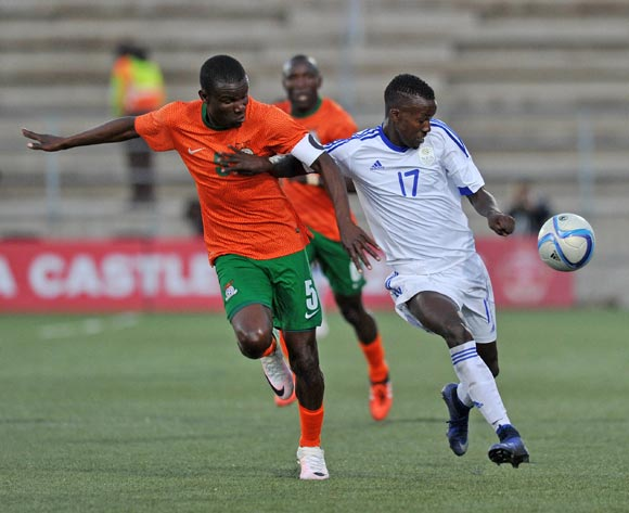 Buchizya Mfune of Zambia challenges Itamunua Keimuine of Namibia during the 2016 Cosafa Cup Plate Final match between Zambia and Namibia at Sam Nujoma Stadium in Windhoek Namibia on 24 June, 2016 ©Muzi Ntombela/BackpagePix