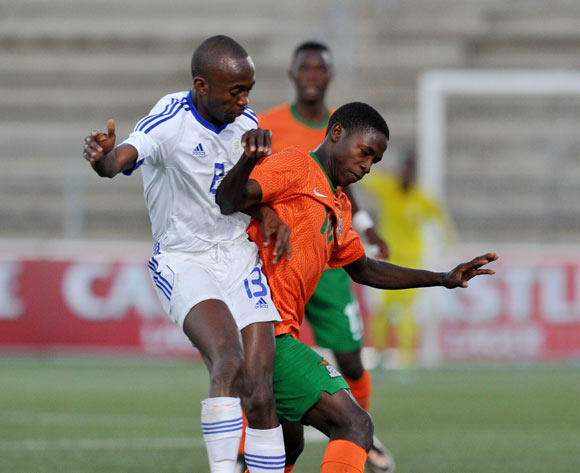 Spencer Sautu of Zambia challenged by Peter Shalilule of Namibia during the 2016 Cosafa Cup Plate Final match between Zambia and Namibia at Sam Nujoma Stadium in Windhoek Namibia on 24 June, 2016 ©Muzi Ntombela/BackpagePix