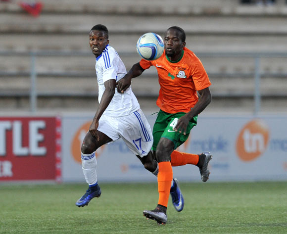 Adrian Chama of Zambia challenged by Itamunua Keimuine of Namibia during the 2016 Cosafa Cup Plate Final match between Zambia and Namibia at Sam Nujoma Stadium in Windhoek Namibia on 24 June, 2016 ©Muzi Ntombela/BackpagePix