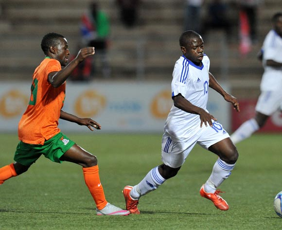 Wangu Gome of Namibia challenged by Jacob Ngulube  of Zambia during the 2016 Cosafa Cup Plate Final match between Zambia and Namibia at Sam Nujoma Stadium in Windhoek Namibia on 24 June, 2016 ©Muzi Ntombela/BackpagePix