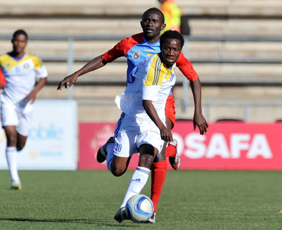 Banele Sikhondze of Swaziland challenged by Junior Baometo of DR Congo during the 2016 Cosafa Cup 3rd Place Play Off match between Swaziland and DR Congo at Sam Nujoma Stadium in Windhoek Namibia on 25 June, 2016 ©Muzi Ntombela/BackpagePix