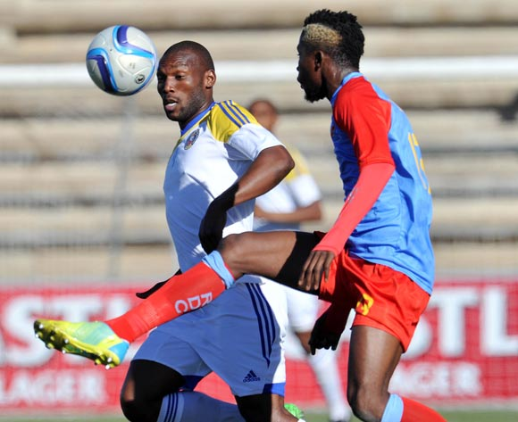 Sabelo Ndzinisa of Swaziland challenged by Rudi Kupa of DR Congo during the 2016 Cosafa Cup 3rd Place Play Off match between Swaziland and DR Congo at Sam Nujoma Stadium in Windhoek Namibia on 25 June, 2016 ©Muzi Ntombela/BackpagePix