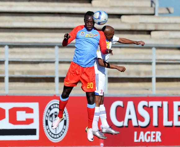 Sedrick Ngulubi of DR Congo challenged by Muzi Dlamini of Swaziland during the 2016 Cosafa Cup 3rd Place Play Off match between Swaziland and DR Congo at Sam Nujoma Stadium in Windhoek Namibia on 25 June, 2016 ©Muzi Ntombela/BackpagePix
