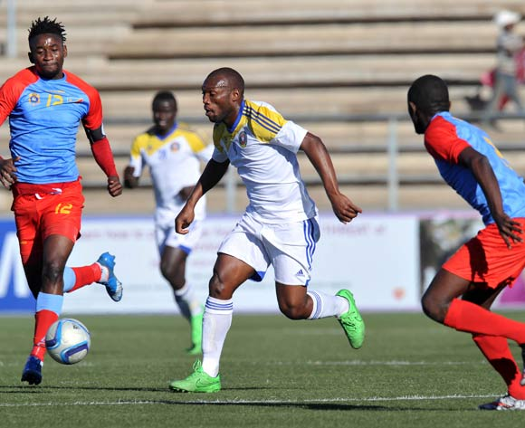 Sabelo Ndzinisa of Swaziland challenged by Bodrick Muselenge and Junior Baometo of DR Congo during the 2016 Cosafa Cup 3rd Place Play Off match between Swaziland and DR Congo at Sam Nujoma Stadium in Windhoek Namibia on 25 June, 2016 ©Muzi Ntombela/BackpagePix