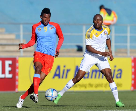 Lobi Manzoki of DR Congo challenged by Sifiso Mabila of Swaziland during the 2016 Cosafa Cup 3rd Place Play Off match between Swaziland and DR Congo at Sam Nujoma Stadium in Windhoek Namibia on 25 June, 2016 ©Muzi Ntombela/BackpagePix